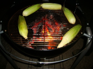 Put around the outside edge of the grill, where it isn't getting direct flame.